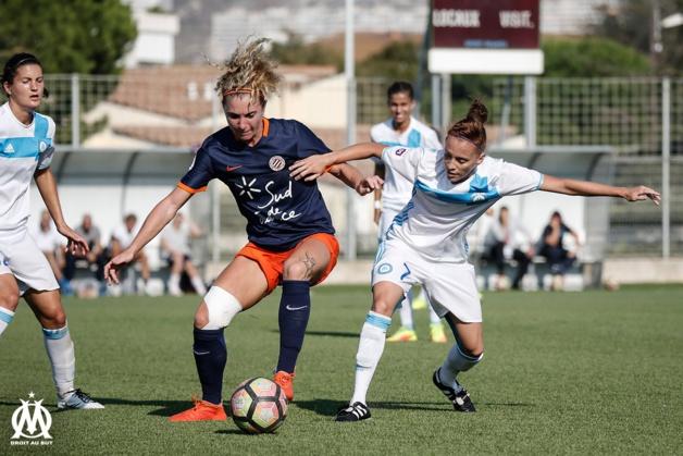 Tonazzi et Coton-Pélagie lors du match OM - Montpellier (photo OM.net)