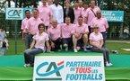 Cécile Lacourt, assise, première à gauche, est ici en compagnie de Marcel Desailly et de l'équipe organisatrice de la finale nationale du Mozaïc Foot Challenge à Clairefontaine, issue des Caisses régionales...